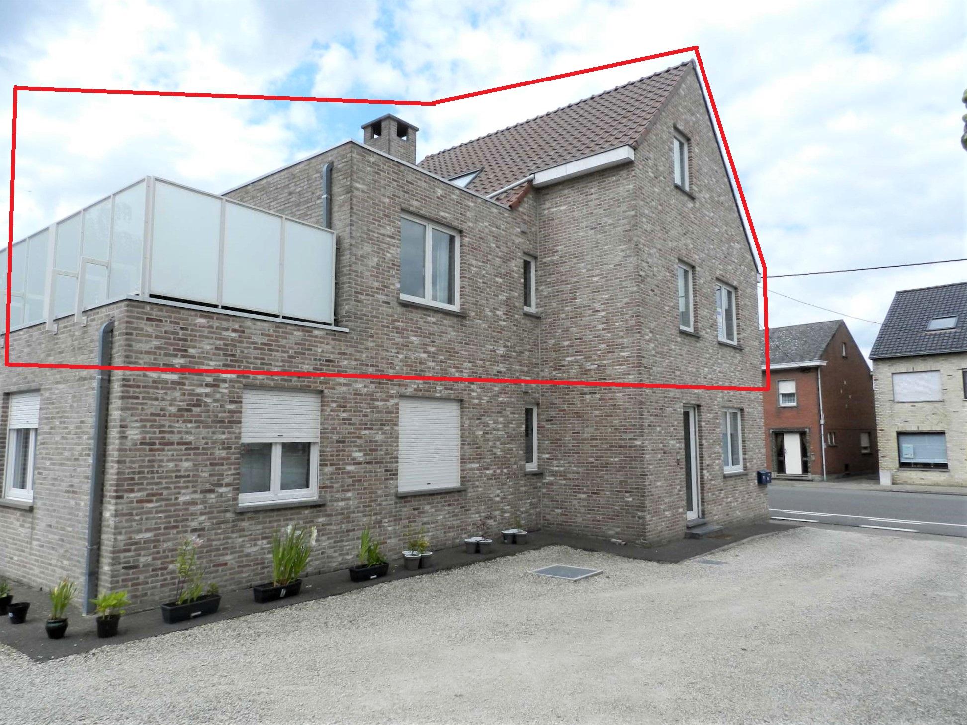 Ruim appartement met dubbele garage en zongericht terras.